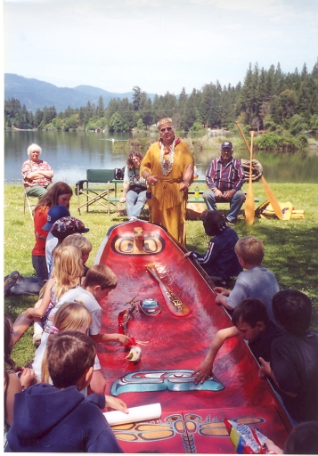 Aggie teaching about Takelma ways with the traditional canoe made by Gray Eagle and George Fence
