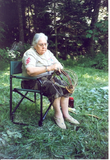 Aggie weaving an egg basket at the Good Medicine Women's Healing Gathering in Williams, 2004