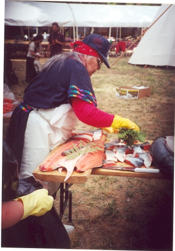 Aggie cleaning salmon with ferns at Applegate Salmon Ceremony, mid-1990s