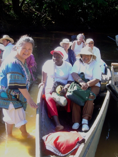 Clara Shinobu Iura welcomes Grandmothers to Mapia, Brazil, via the Amazon River, 2005