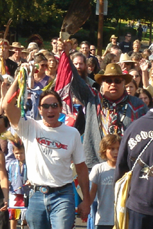 Dan Wahpepah and David West lead the ceremonial walk to the sculpture dedication